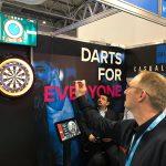 Toby tries his arm at darts