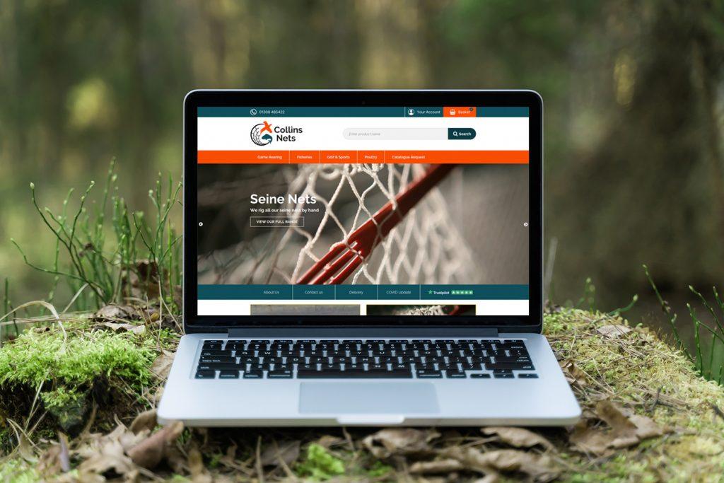 Colin nets website on macbook outdoors